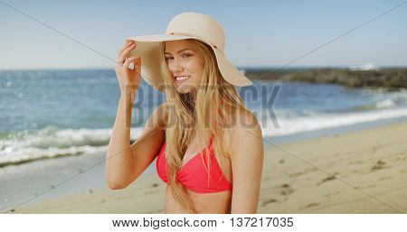 Lovely Young Woman Enjoying Her Time At The Beach