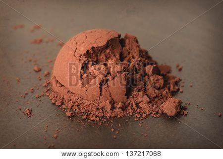 1 spoon of cocoa powder, abstract cocoa powder