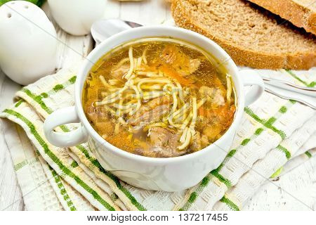 Soup With Mushrooms And Noodles In Bowl On Napkin