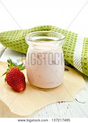Yogurt With Strawberries In Jar On Light Board