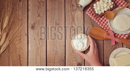 Farm fresh dairy products on wooden background. Healthy eating concept. View from above. Flat lay