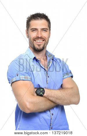 Portrait of a handsome casual man smiling with arms  folded