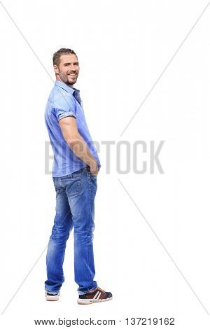 man in a full-length white background turns from a shoulder
