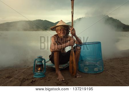Portrait of an old fisherman of the Mekong River.