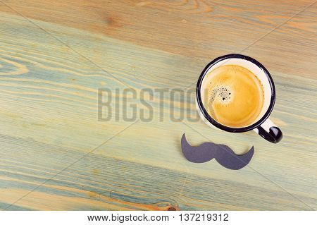 Father's day holiday background with coffee cup and paper mustache. View from above