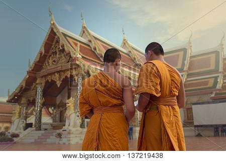 Back side two novices Facing the Buddhist church