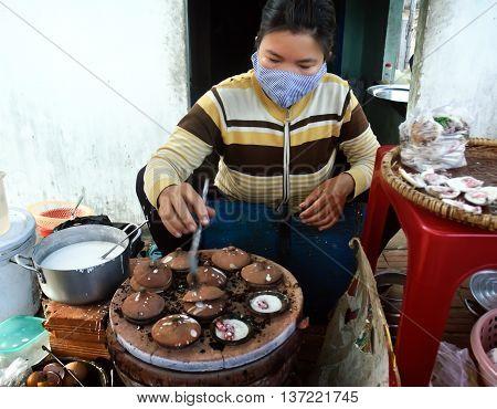 PHU YEN, VIET NAM, May 23, 2016 the woman, countryside Phu Yen, Vietnam. processed rice cakes, bread called XEO