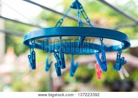 Plastic clothes pegs in blur background, washing, home work