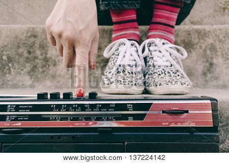 Hip hop woman with a tape recorder enjoying music