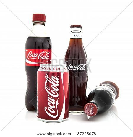 SWINDON UK - JANUARY 19 2014: Colection of Coca-Cola dinks in bottles and cans on a white background