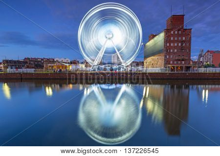 Ferris wheel in the old town of Gdansk at night, Poland