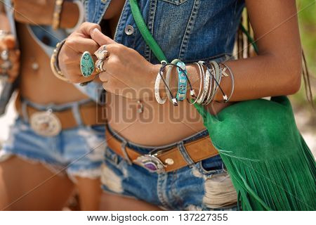 close up of beautiful hippie girls with green field background