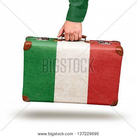 Hand holding vintage Italian flag suitcase isolated on white