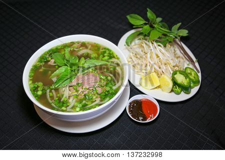 Bun bo or Vietnamese vermicelli noodle soup with minced beef