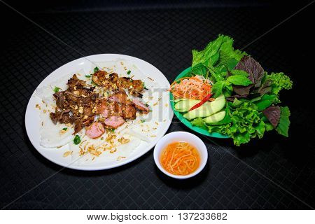 Banh hoi or Vietnamese soft thin vermicelli noodles with herbs and pork