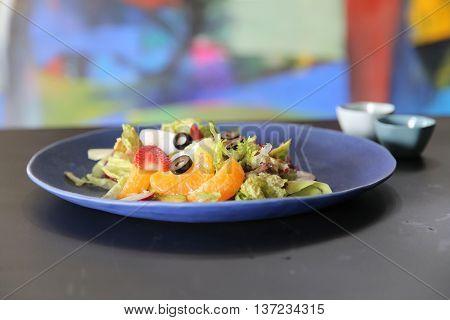 Vietnamese salad of orange strawberry and vegetables