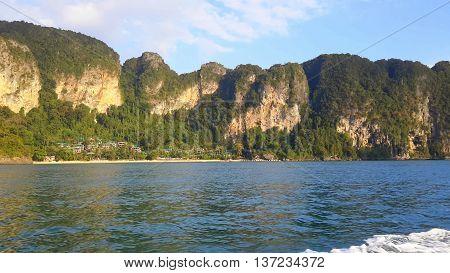 Cliffs near Ao Nung, Thailand, seen from a Thai longtail boat