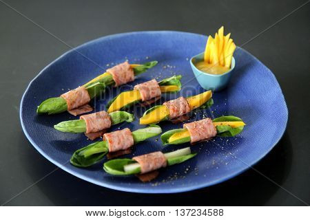 Vietnamese rolls of pork mango and cabbage