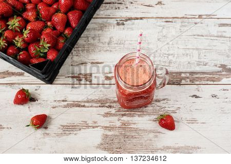 Fresh Juice, Shake, Milkshake Of Strawberries In A Mason Jar With A Straw. Pile Of Juicy Ripe Organi