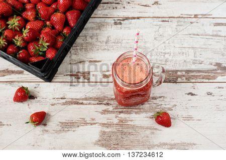 Fresh Juice, Shake, Milkshake Of Strawberries In A Mason Jar With A Straw. Pile Of Juicy Ripe Organi