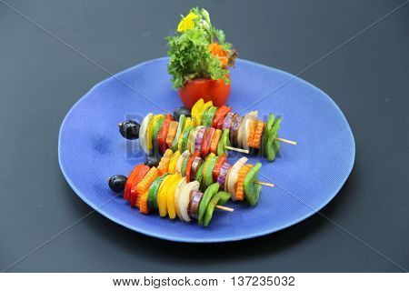 Skewers of carrot chili onion cucumber that serving in the restaurant