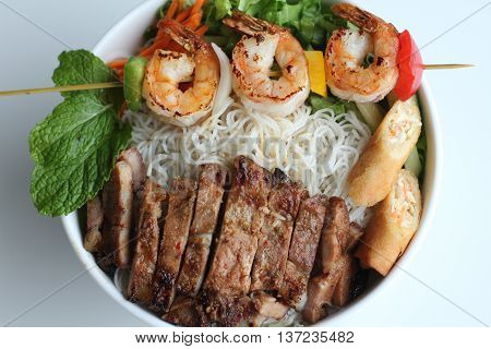 Bun thit nuong or grilled shrimp beef spring rolls vermicelli