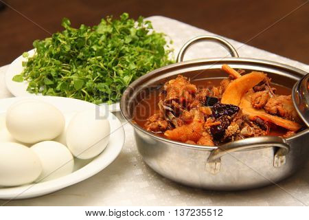 Stewed chicken with herbs and egg that serving in the restaurant