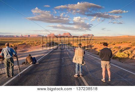MONUMENT VALLEY, USA - OCTOBER 4, 2015: Photographers taking pictures on the road leading to Monument Valley