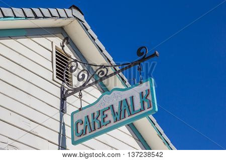 COULTERRVILLE, CA, USA - OCTOBER 9, 2015: Vintage cakewalk sign on a building in main street Coulterville, California