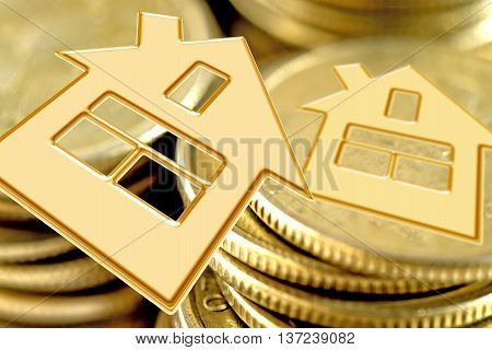Golden symbol of a private house on a background of money