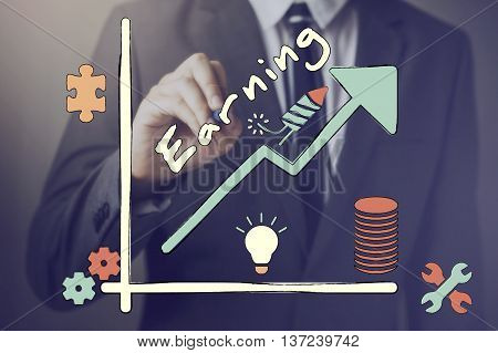 Businessman Drawing A Graph Of Increasing Earning