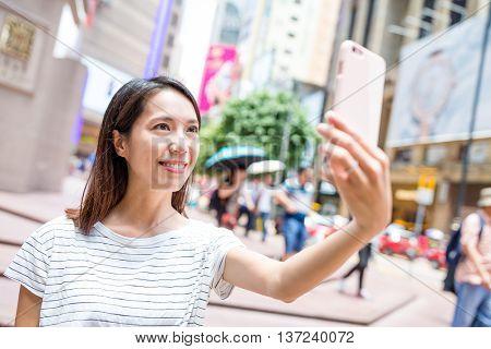 Woman taking selfie in causeway bay