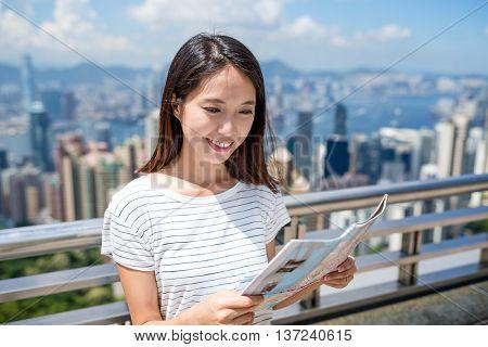 Woman using the city map in Hong Kong