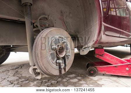car take wheel off show brake disk and caliper assembly