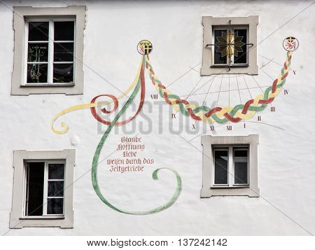 Sundial on the old wall in Passau Germany. Architectural theme. Ancient building. Cultural heritage. Artistic scene. Time measurement.