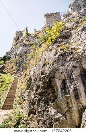 Beckov castle ruins Slovak republic central Europe. Vertical composition. Travel destination. Beautiful place. Cultural heritage. Big rock.