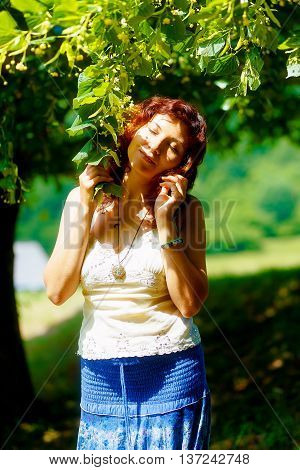 Gentle Prayer To A Beautiful Linden Tree On Bright Midsummer Day