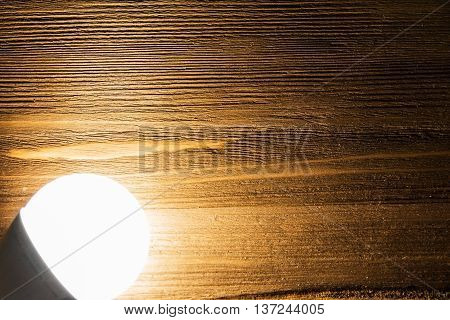 luminous light and shadow on the wooden background