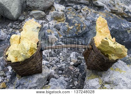 Basket Full Of Sulfur Nuggets Atop A Volcano In Indonesia
