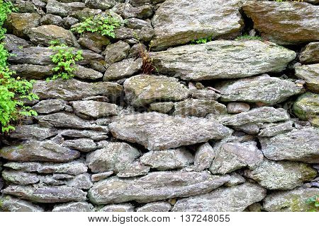 Background of old cobblestones texture old ancient construction