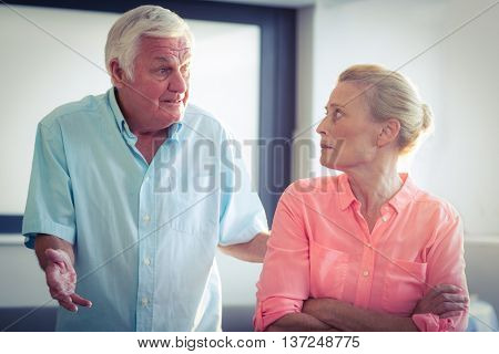 Senior man shouting on senior woman at home