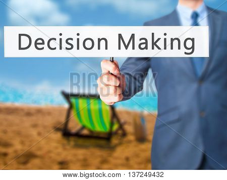Decision Making  - Businessman Hand Holding Sign