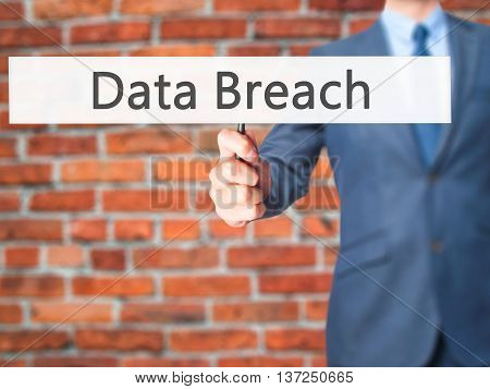 Data Breach - Businessman Hand Holding Sign