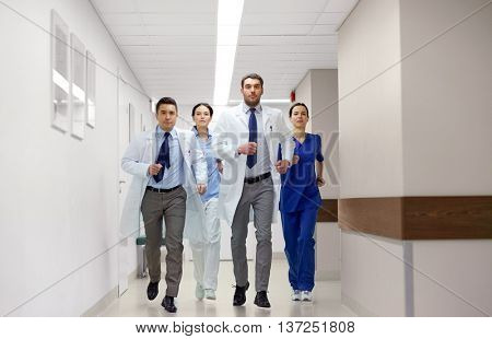 clinic, people, health care and medicine concept - group of medics runing along hospital