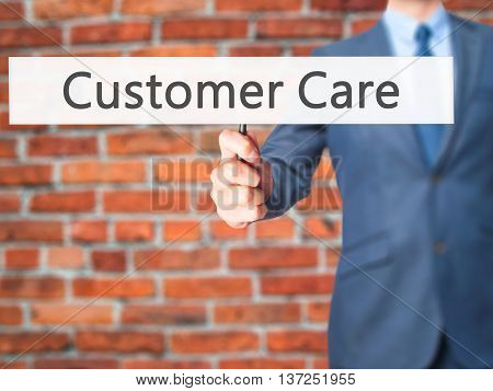 Customer Care - Businessman Hand Holding Sign