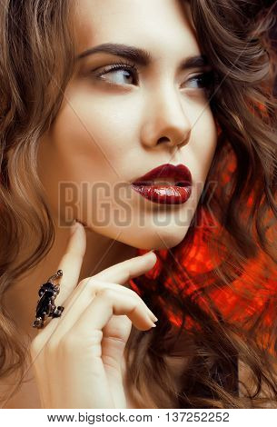 Beauty Woman with Perfect Makeup Beautiful Professional Holiday Make-up. Red Lips and Nails Beauty Girls Face isolated on Black background Glamorous Woman