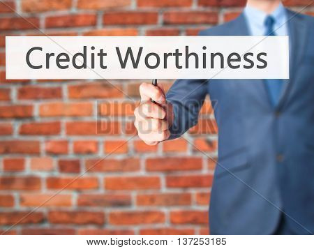 Credit Worthiness - Businessman Hand Holding Sign