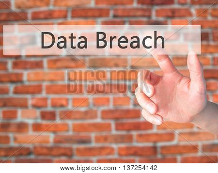 Data Breach - Hand Pressing A Button On Blurred Background Concept On Visual Screen.