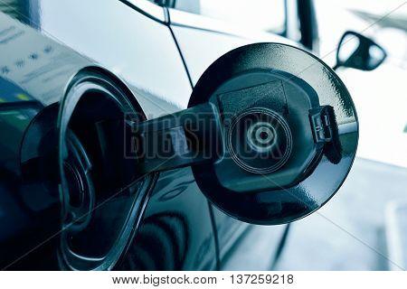 closeup of the fill cap of the fuel tank of a car