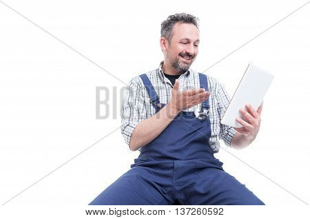 Happy Handyman Wathcing Something Funny On Tablet